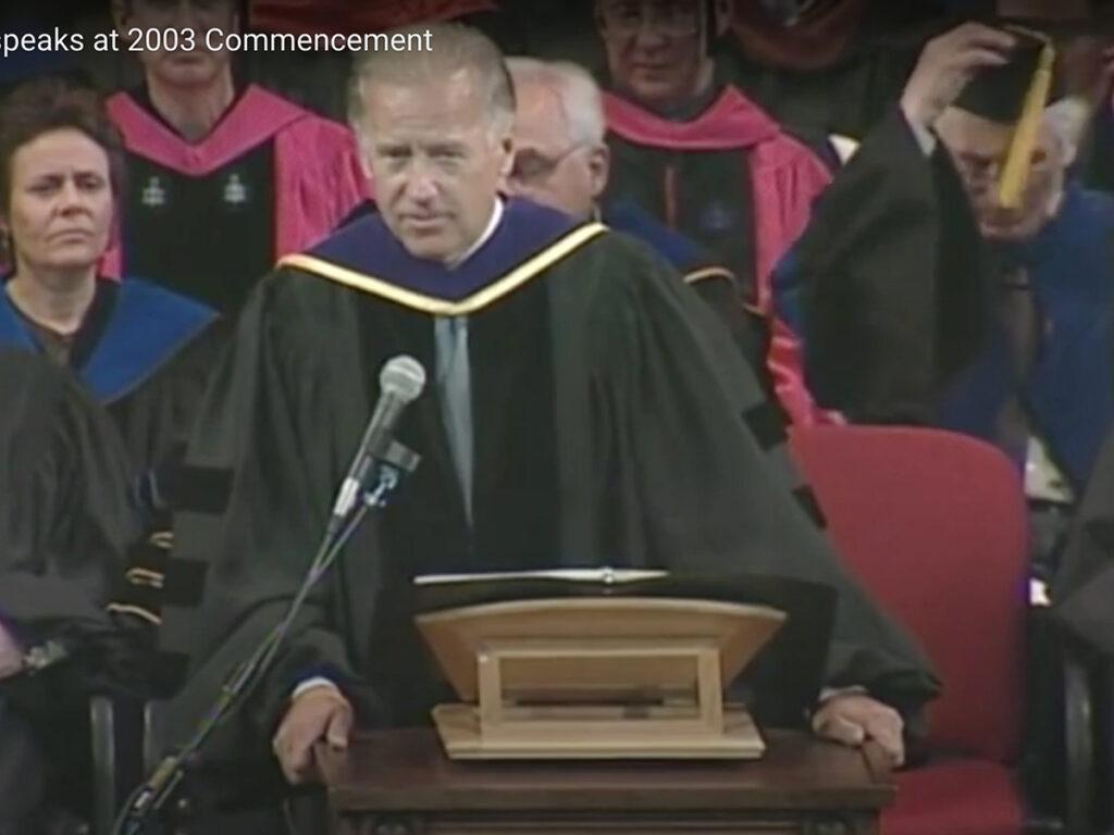 screen shot of joe biden in regalia at podium