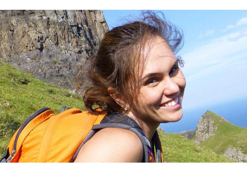 Headshot of woman on grassy hill