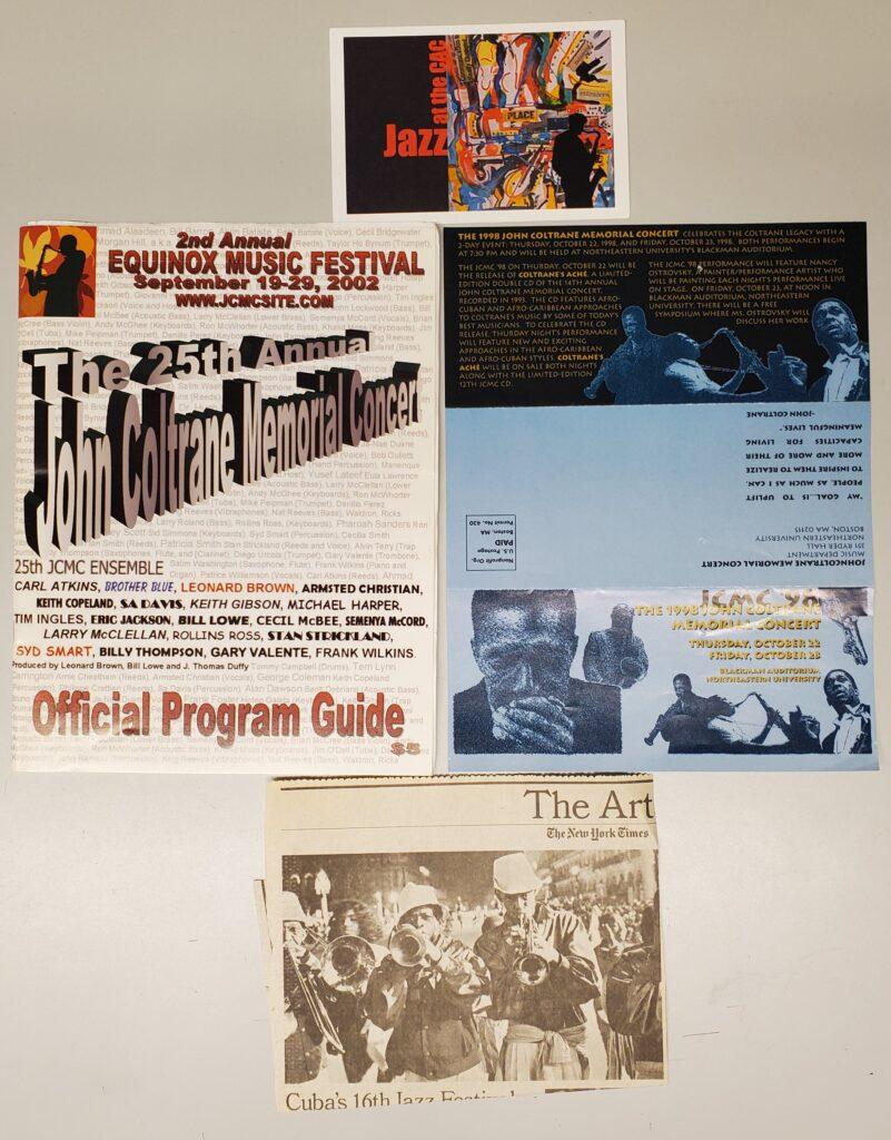 A musical festival postcard, a concert program, clip of a newspaper article, and a concert advertisement