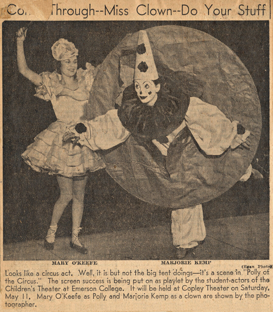 An old newspaper photo of someone dressed as a clown and another person in a dress