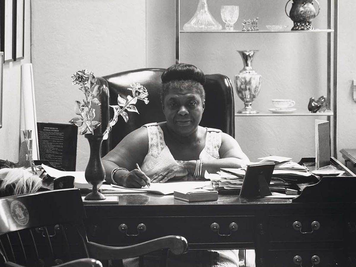 Ms. Elma Lewis at desk