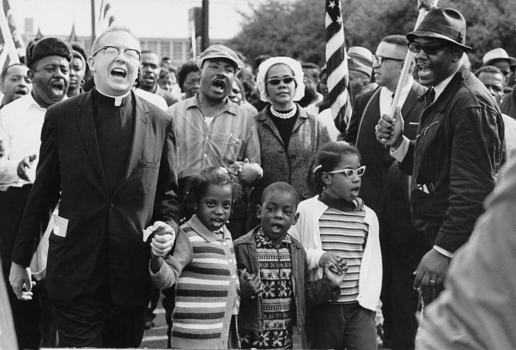 People sing on day four of the Selma to Montgomery March.