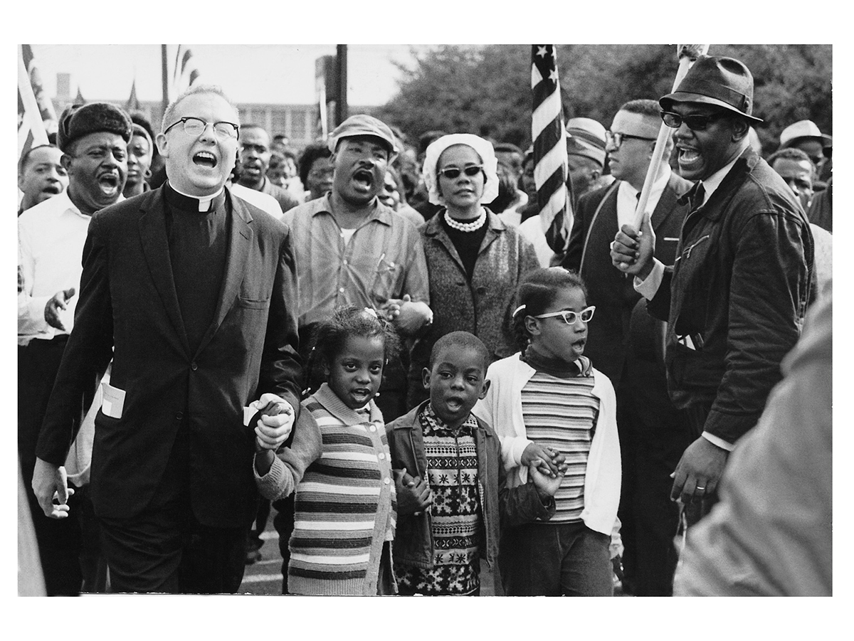People and children sing during the Selma to Montgomery March