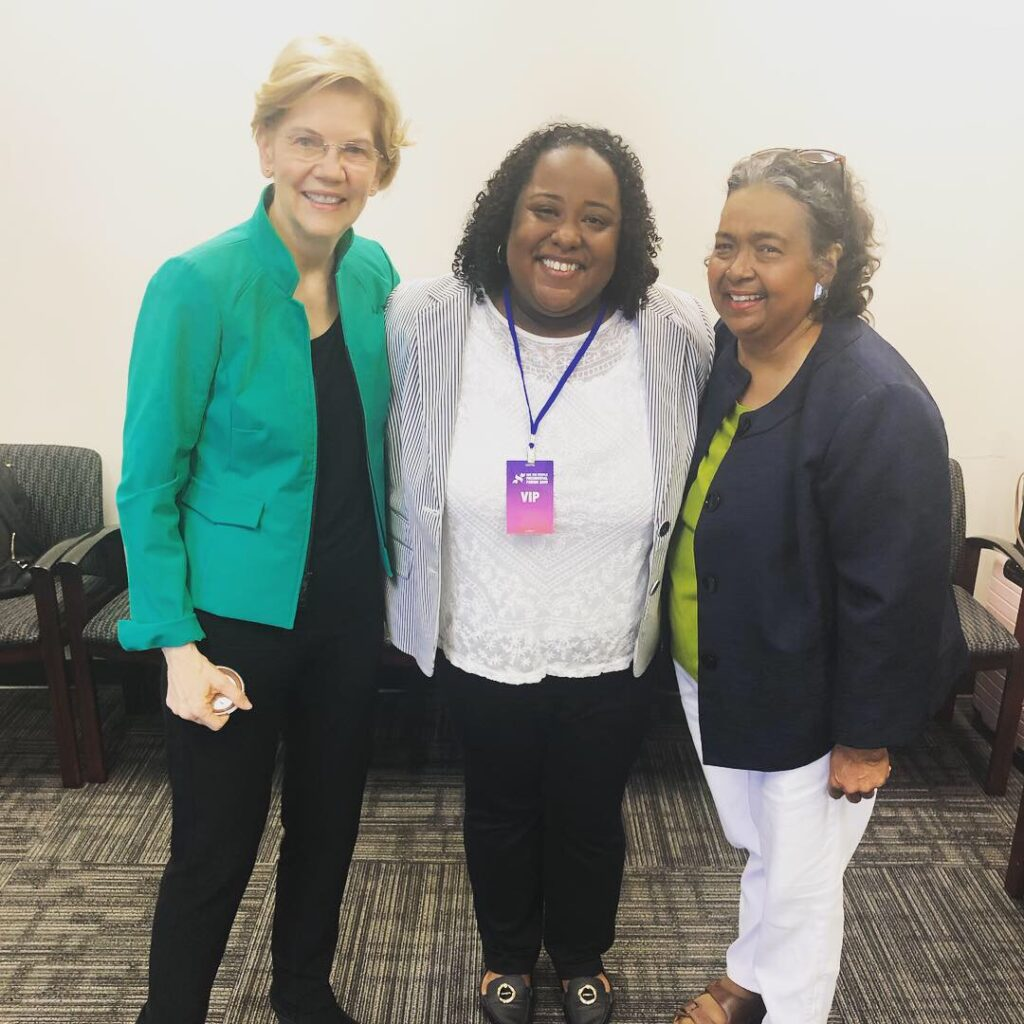 Three women stand with each other