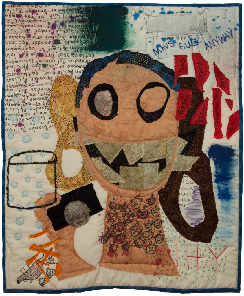 A quilt showing a head