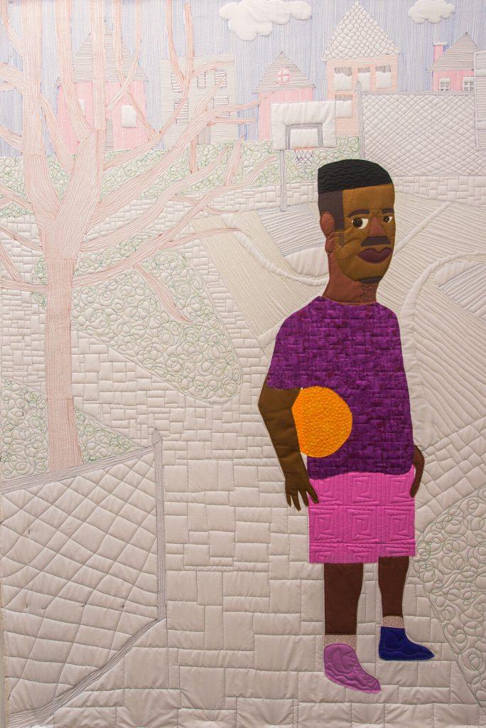 A quilt of a man holding an orange ball