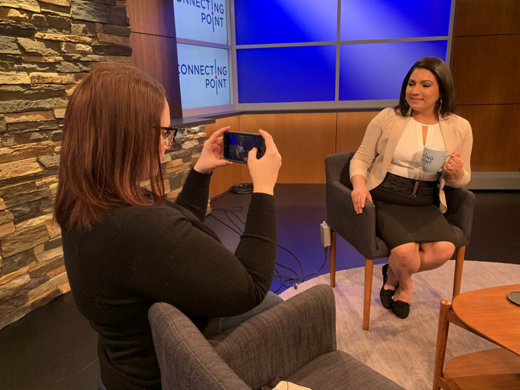 Rachel Scott takes photo of colleague on set with phone