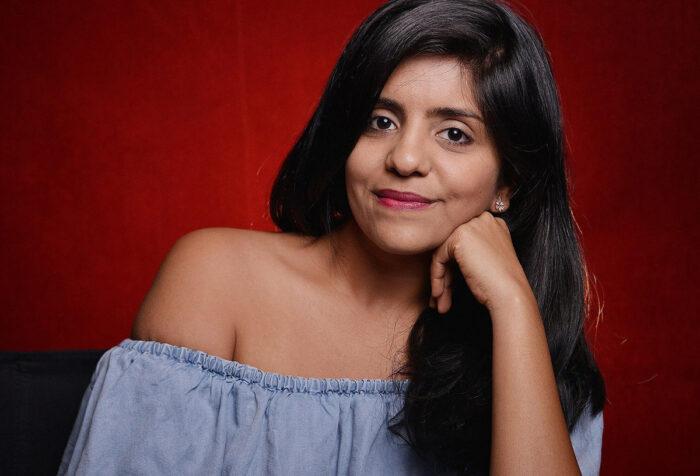 Jhanvi Motla against red background