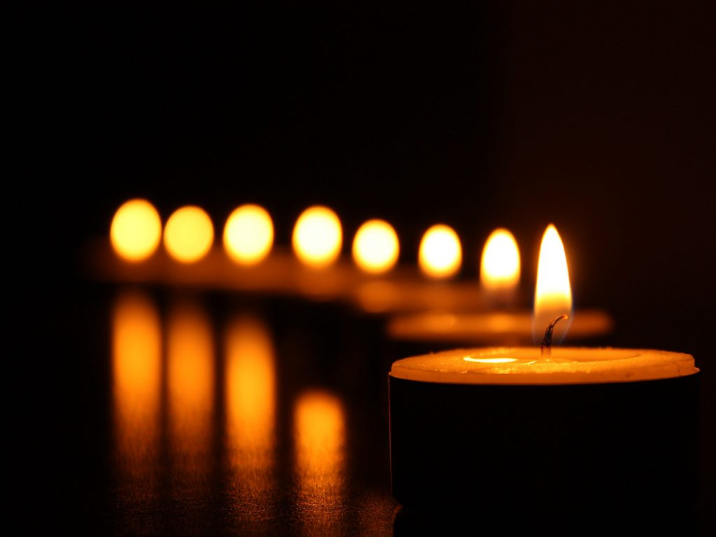 line of lit votive candle