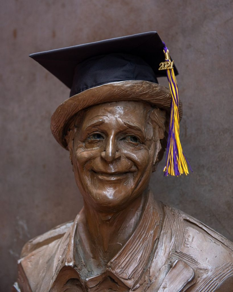 Bust of statue with graduation hat on top
