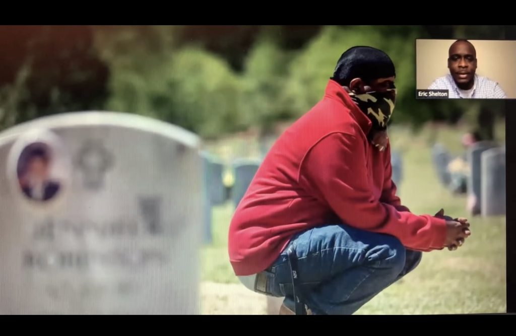 Man wearing mask crouching in a cemetary