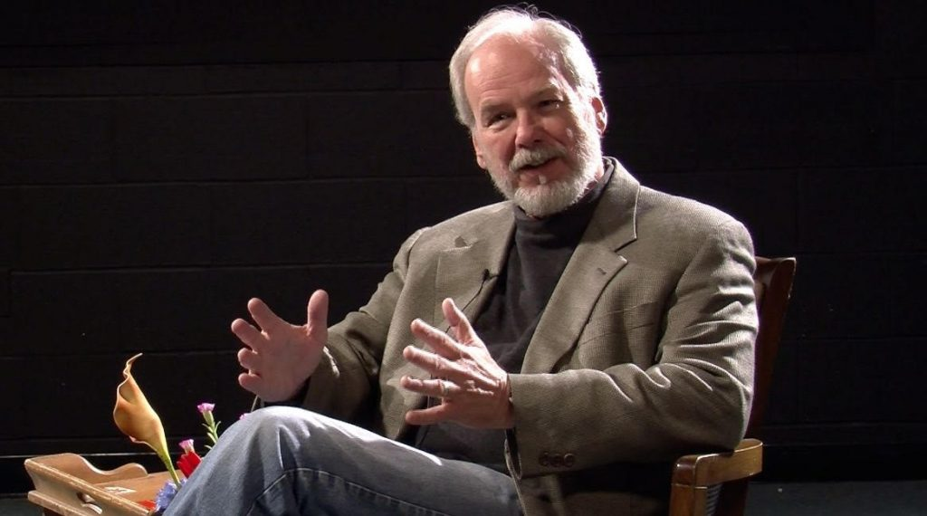 richard hoffman sitting and speaking on stage