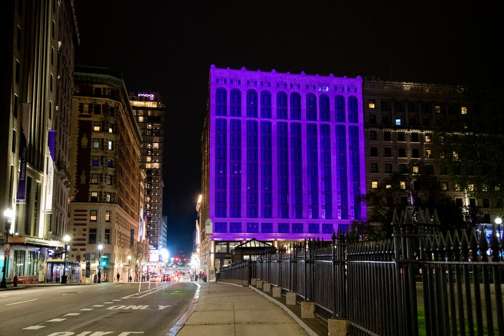 The Little Building is lit up in purple