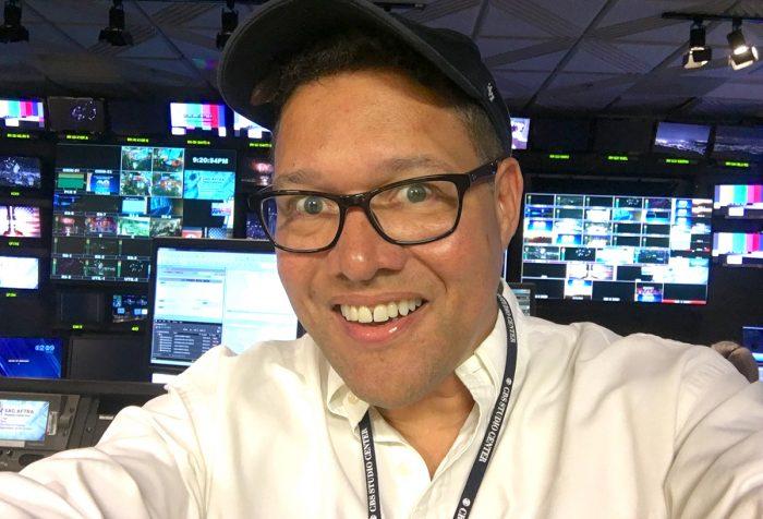 charles stewart in baseball cap in news studio