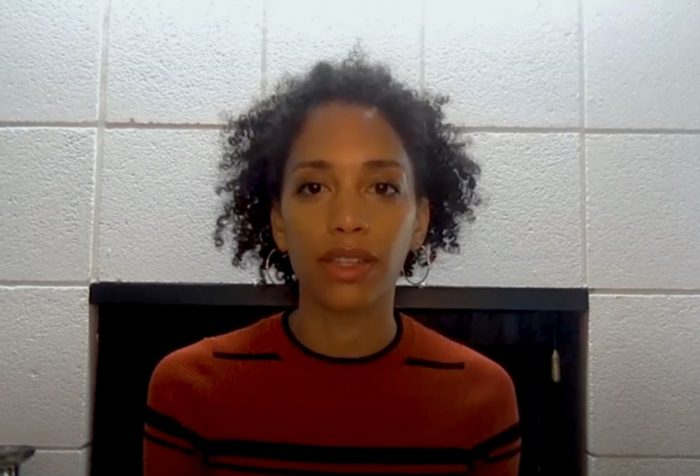 Stefani Robinson speaks in front of white fireplace