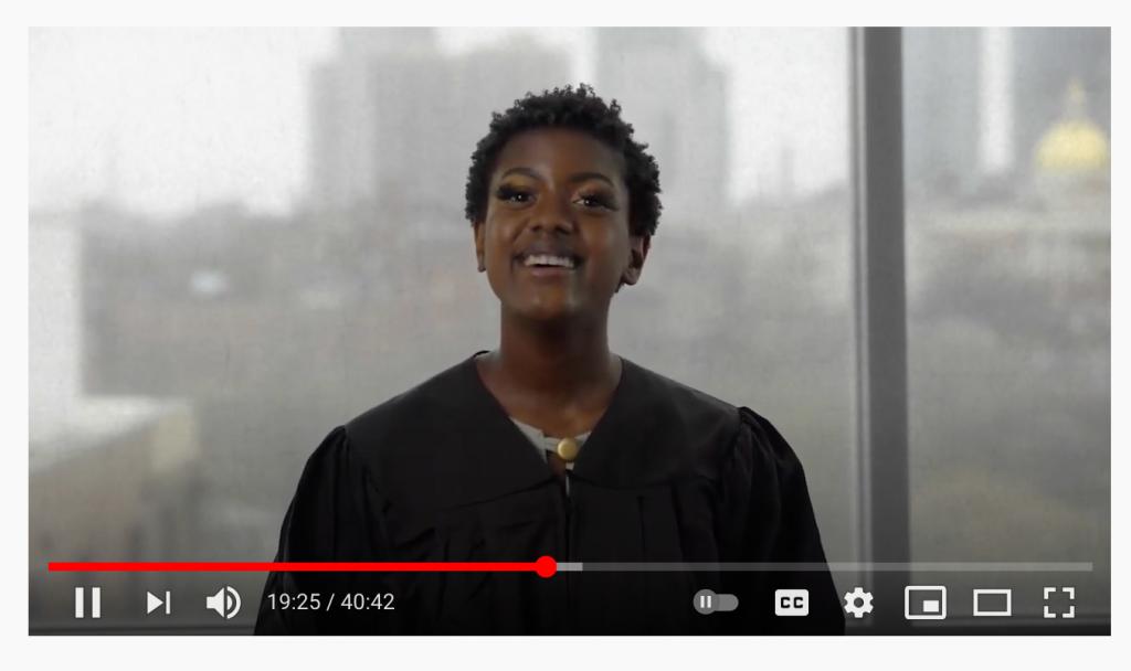 Naomi Jones speaks in front of window