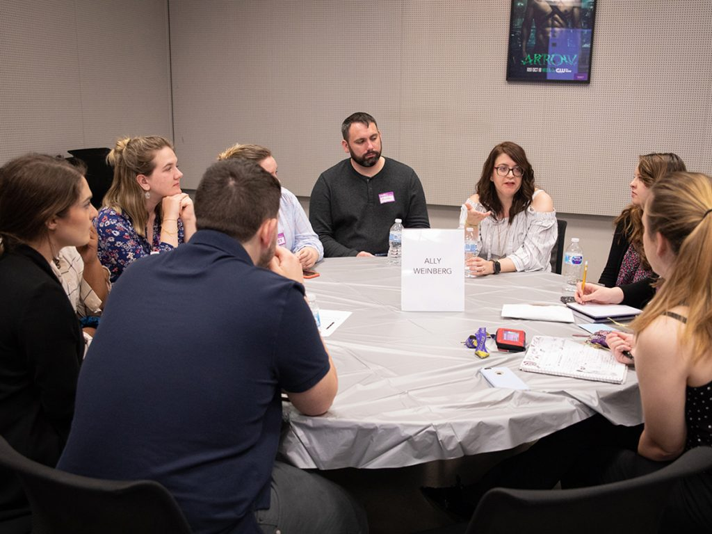 Ally Weinberg speaks at round table