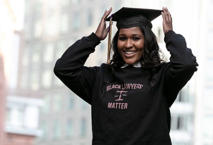 Erica Jones in Black Lawyers Matter sweatshirt and mortarboard on Boston street