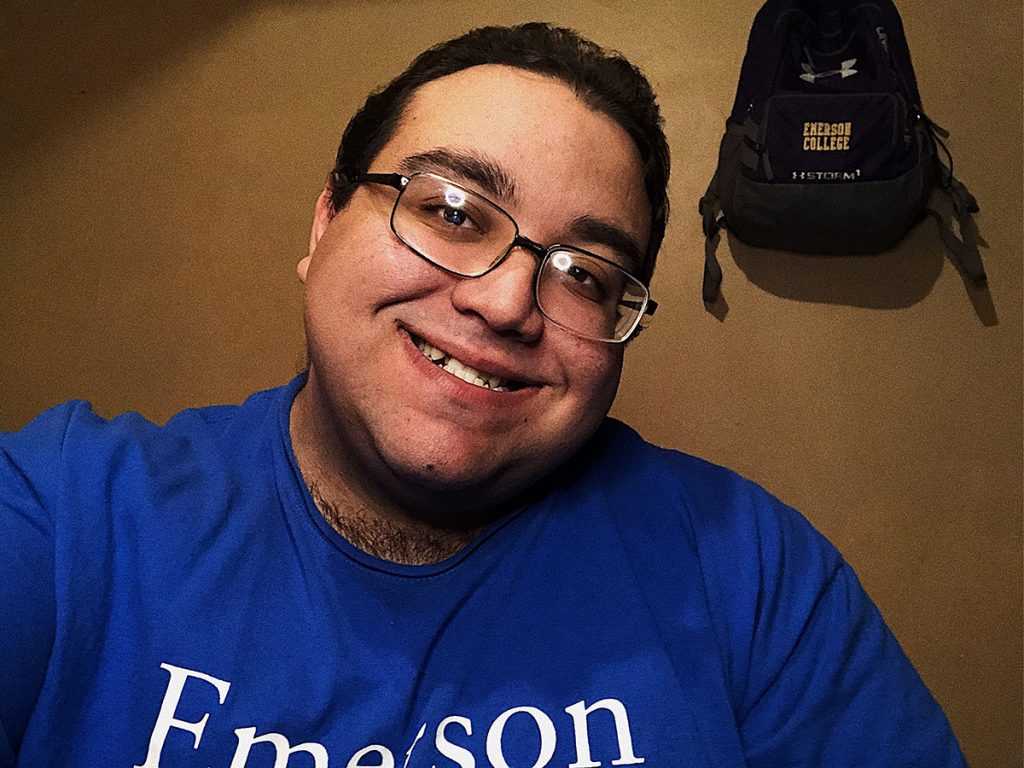 Anthony Rodriguez in Emerson T-shirt with Emerson backpack hanging behind him