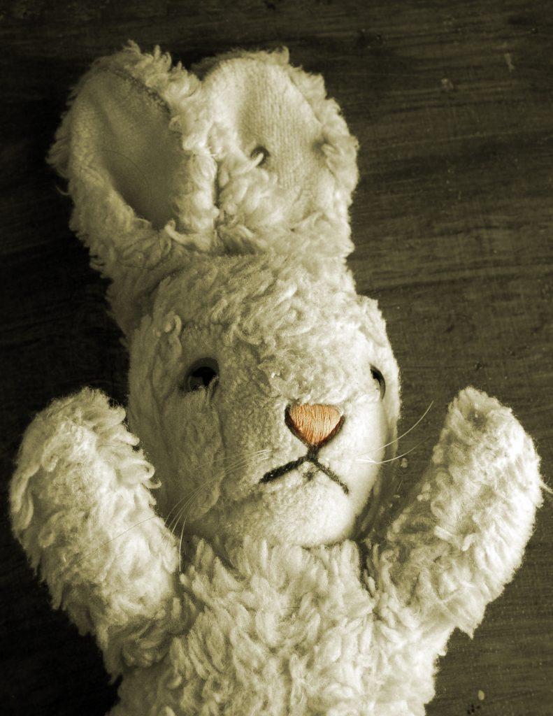 A stuffed animal white rabbit