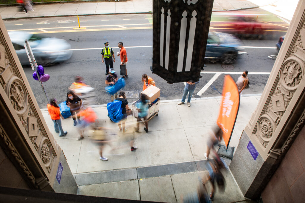 A bird's eye view looking down at Boylston Street while people move-in to the building
