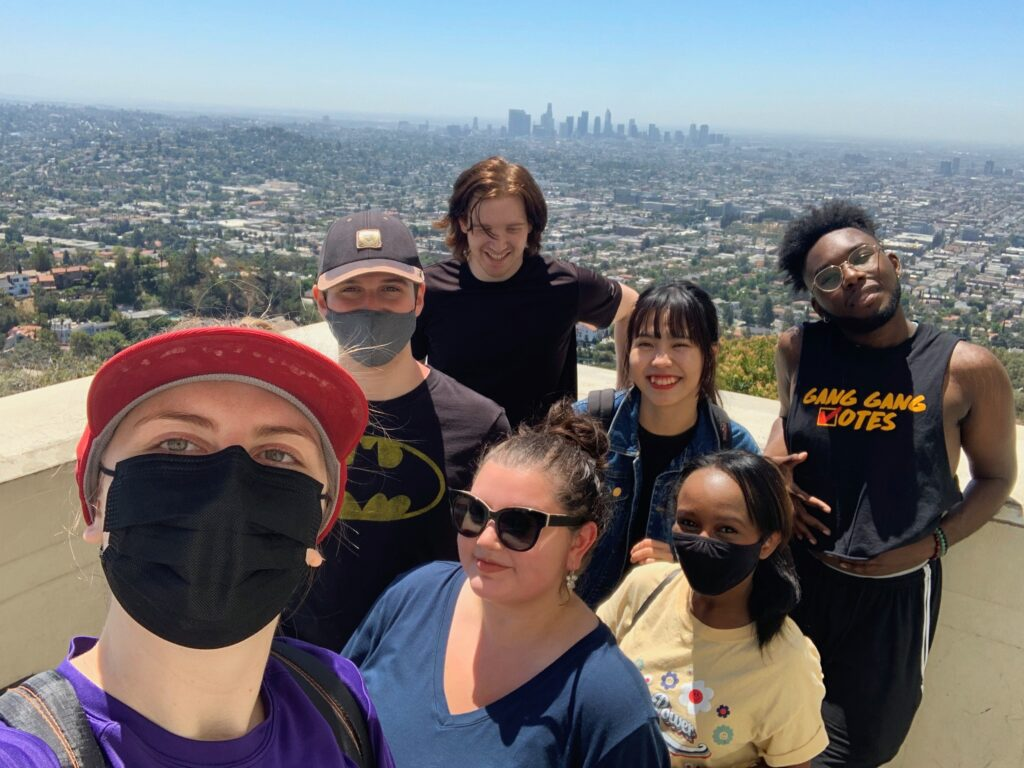 seven students take selfie atop Griffith Park