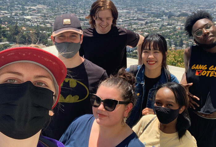 seven students take selfie at top of griffith park