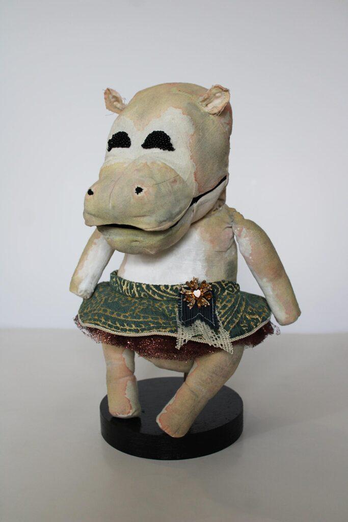 A hippo puppet wearing a ballerina tutu