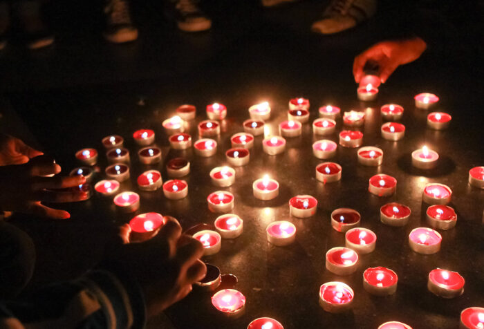 lit votive candles at night