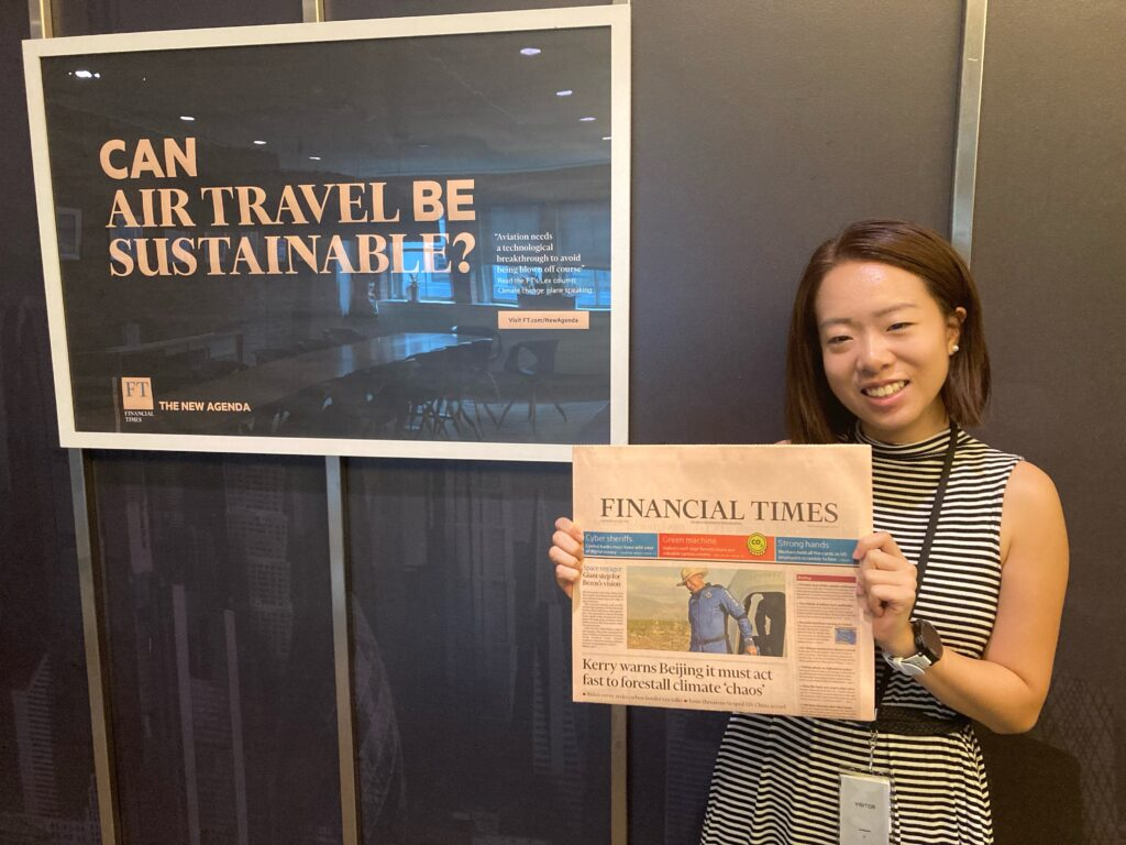 Posing with a newspaper, Jocelyn Yang '22 spent this summer producing bylines for The Financial Times.