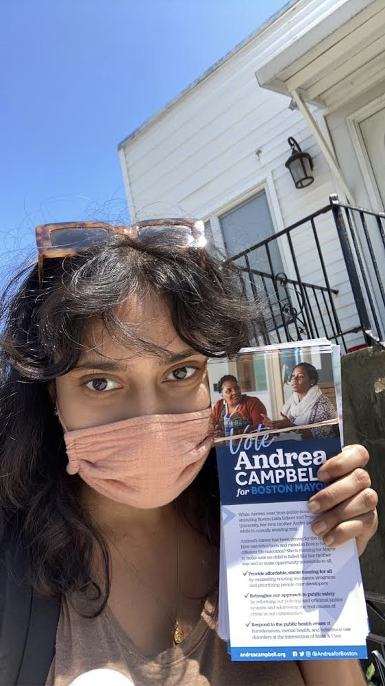 Andrew Campbell Campaign Fellow, Sonali Anand '21., poses with a voter's brochure.