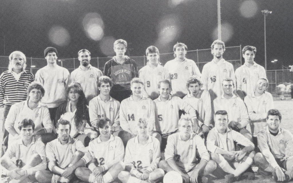 black and white co-ed soccer team photo