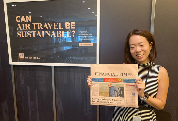 Jocelyn Yang holds up a copy of The Financial Times