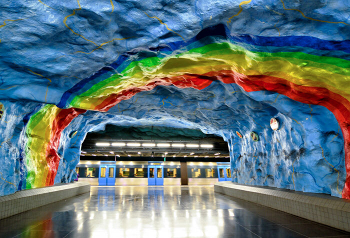 view of Stockholm subway from tunnel painted with rainbow